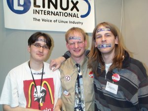 Picture of Marc Lehmann, Torsten Scheck and Stefan Traby fighting software patents at CeBit 2002.